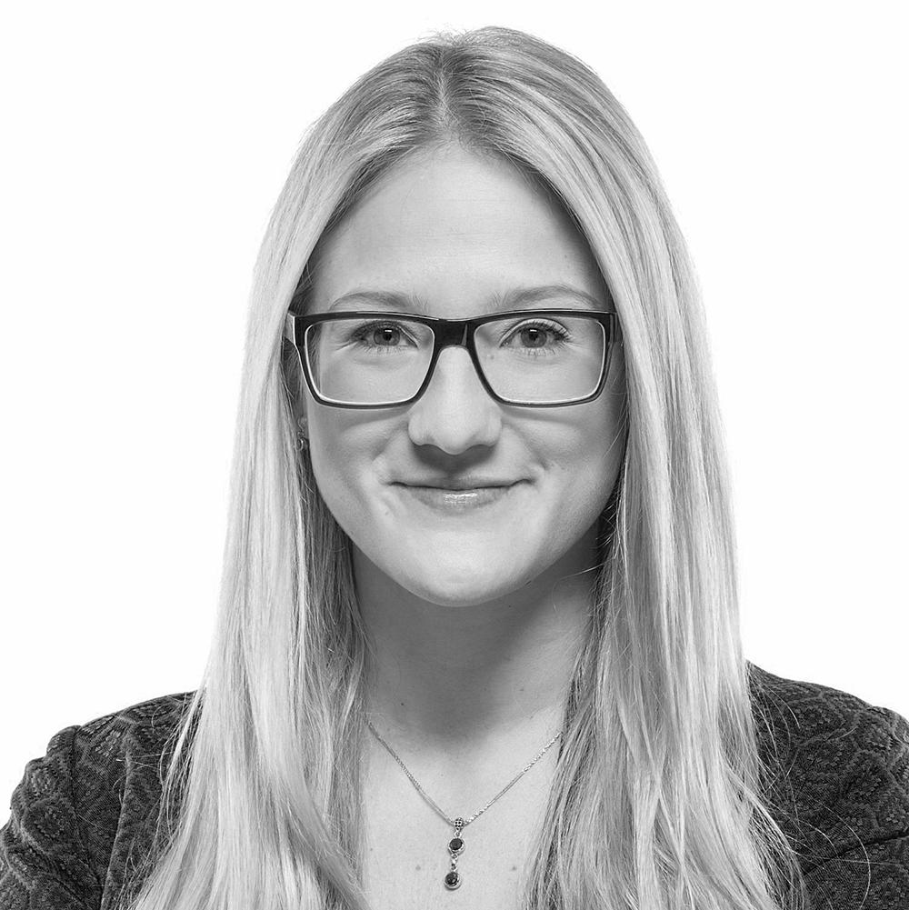 Black and white headshot of Jessica Van Acker